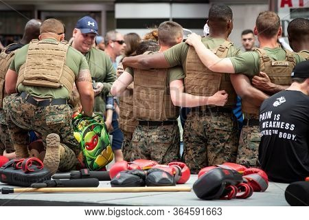 MAY 24 2019-NEW YORK: U.S. Marines gather for a group photo at the Armed Forces Recruiting Station Military Island Plaza in Times Square after a MCMAP demonstration during Fleet Week on May 24, 2019.