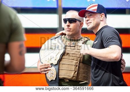 MAY 24 2019-NEW YORK: American mixed martial artist champion Colby Covington and a U.S. Marine pose for a photo at the Armed Forces Recruiting Station in Times Square, Fleet Week on May 24, 2019.