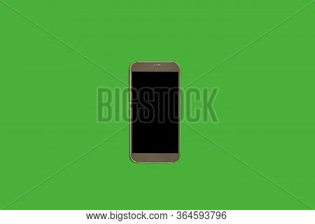 New Modern Smart Phone Lying On A Green Background With A Turned Off Screen. Concept Of Gadgets
