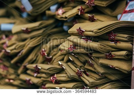 Stack Of Military Caps Of The Soviet Army With Red Stars. Garrison Cap With A Red Stars. Red Stars W