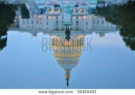US Capitol Building view from reflection pool  at sunrise - Washington DC United States
