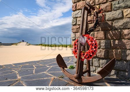 Dunkirk, France - August 13, 2019: Close Up Of The Anchor With Poppies At The End Of The Operation D