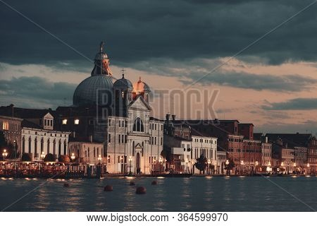 Venice skyline at night with historical architectures in Italy.