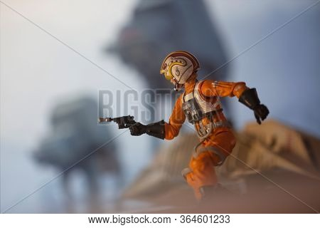 MAY 2 2020: Recreation of a scene from Star Wars The Empire Strikes Back with Luke Skywalker escaping his downed snowspeeder avoiding ATATs - Hasbro action figures