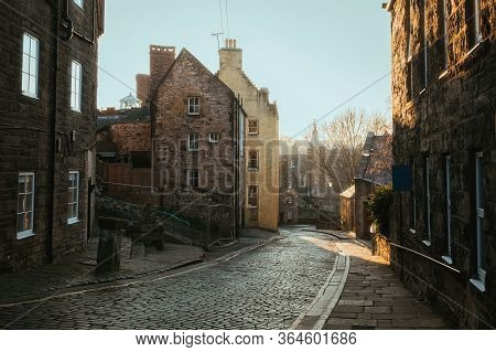 View On Old Houses And A Street In Dean Village. New Town Part Of Edinburgh City, Capital Of Scotlan