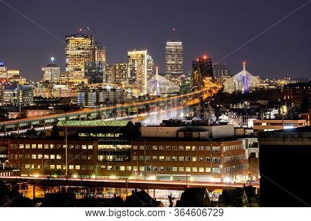 Night Boston Skycraper Skylines office downtown building with along Boston bay harbor at from Chelsea district. Boston is the capital city of the Commonwealth of Massachusetts in the United States
