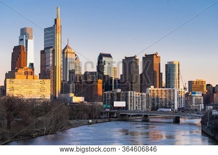 Cityscape of Philadelphia skyscraper Skylines building sunset along river in Philly city downtown of Philadelphia in PA USA. Cityscape Urban lifstyle concept.