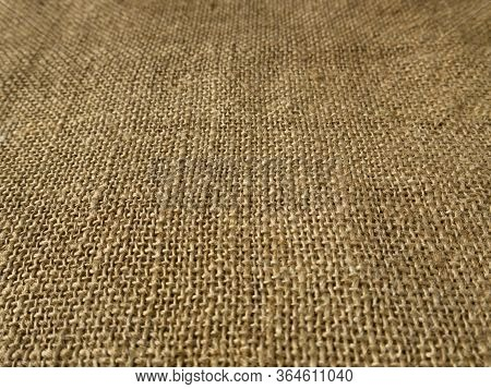 Background Made Of Natural Rustic Sackcloth. Clear Textured Burlap Surface In Perspective.