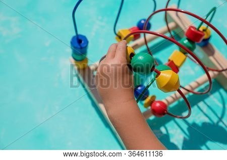 Baby Playing With Educational Toy In Nursery. Learning Colorful Wooden Toy.developing Toy.labyrinth