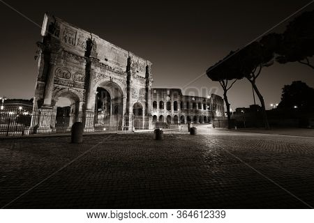 Colosseum and Arch of Constantine closeup at night in Rome Italy