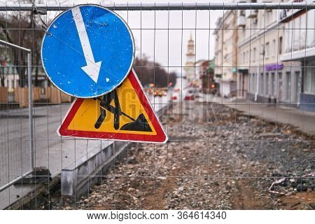 Road Signs Roadworks Ahead And Pass On This Side On The Fence In Front Of A Street With A Removed Pa