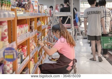 Bangkok, Thailand - May 02: Bangkok, Thailand - May 02: Supermarket Employees Stocks Shelves With In