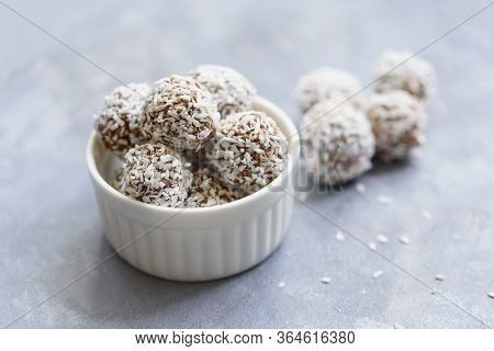Healthy Raw Energy Balls With Cocoa, Coconut, Sesame, Chia On White Background.