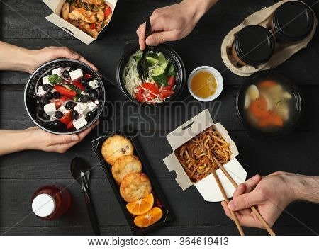 People Eat Takeaway. Food Delivery. Tasty Food On Wooden Table