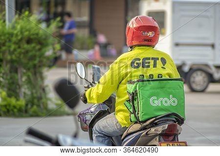 Bangkok, Thailand - May 02: Delivery Rider Works Simultaneously With Grab Food And Get! In Bangkok O