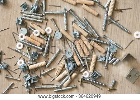 Assembly On Top Of A Group Of Parts Dowel, Bolt, Washer, Screw For Assembling Wooden Furniture, Read