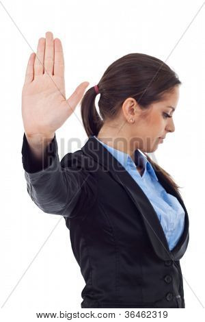 Serious young business woman making stop sign over white, focus on hand