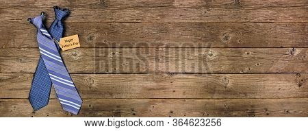Happy Fathers Day Gift Tag With Blue Ties On A Rustic Wood Banner Background With Copy Space