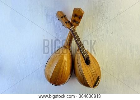 Lute - A Stringed Musical Instrument With Frets On The Fretboard.