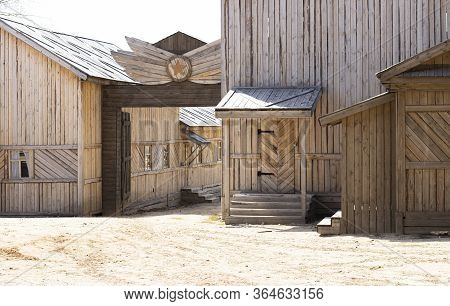 Old Wooden Houses With Wooden Roofs And Windows. Village Of Rare Wooden Buildings
