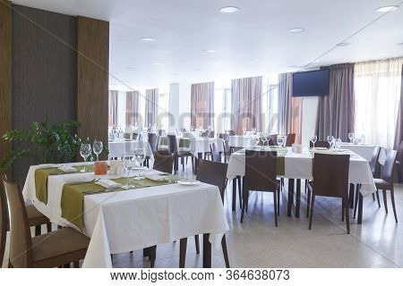 Luxury Restaurant Interior With Potted Plants, Daylight. Nobody Inside