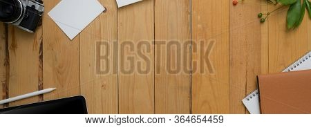 Top View Of Modern Rustic Workspace With Office Supplies And Copy Space
