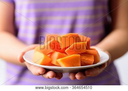 Sliced Ripe Papaya Fruit On White Plate Holding By Hand Ready To Eating, Tropical Fruit, Healthy Foo