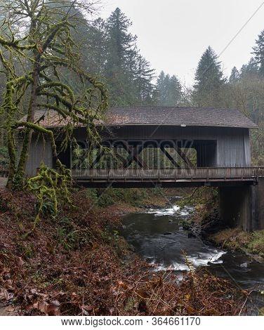 Covered Bridge At Cedar Creek Grist Mill In Washington State