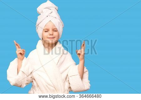 Spa Skin Care Beauty Girl Wearing Hair Towel And White Coat After Beauty Treatment Crossing Fingers,