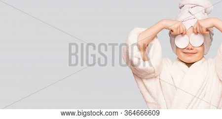 Banner View Of Beautiful Kid Girl With Towel On Head Hold Cotton Pad Disk Cleansing Face Skin With C