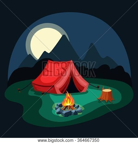 Tent At Night In The Camp. Red Tent On Green Meadow With Campfire, Wooden Stump With Remains Of Bark