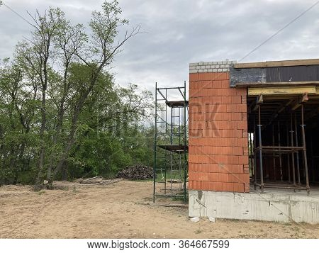Close Up Of Unfinished House In Residential Area. Modern Architecture Of Construction Brick House Fo