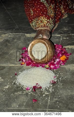 Indian Bride Pushing Pot Filled With Rice In Wedding, Indian Marriage Traditions