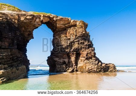 Wonderful Stone Figures. Eroded Beach Coastline. Cathedrals Beach At The Atlantic Ocean, Cantabric C