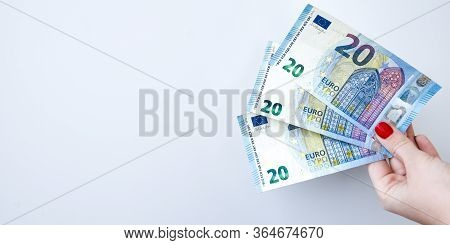 Womans Hand With 20 Euros Money On A White Background, Copy Space For Text, Close Up Of Female Hands