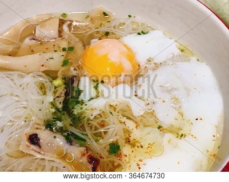 Asian Noodle Soup And Eggs And Squids In Bowl