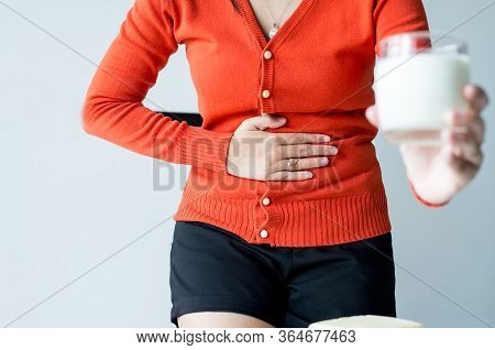 Woman Having A Stomach Ache And Hands Holding A Glass Of Milk,allergy Dairy Intolerant,lactose Intol
