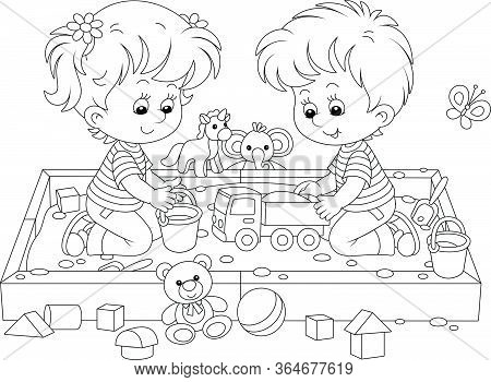 Happy Small Children Friendly Smiling, Romping And Playing With Their Funny Toys In A Sandbox On A P