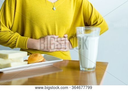 Woman Having A Stomach Pain And A Glass Of Milk,allergy Dairy Intolerant,lactose Intolerance Concept