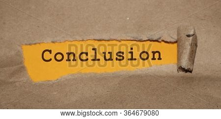 Conclusion Word Written Under Torn Paper. Education Concept
