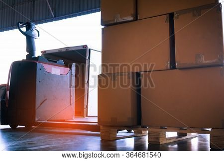 Electric Forklift Pallet Jack Loading Shipment Goods, Stack Package Boxes On Pallet
