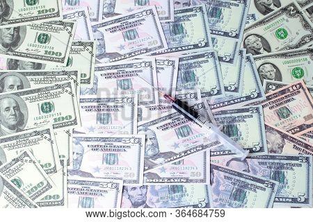 Varites Dollar Money And Blood In Syringe On Banknotes Lay Spread Double.
