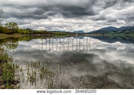 Reflection Of Clouds On Thy Sky In Lake Liptovska Mara, Slovakia