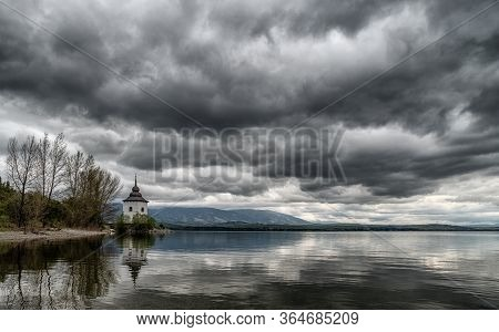 Dramatic Grey Clouds On The Sky. Reflections On  Lake Liptovska Mara, Slovakia