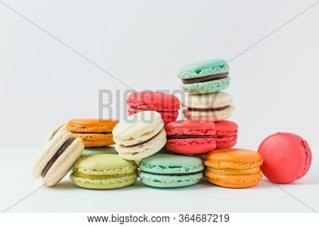 Beautiful Colorful Desserts. French Macaroons On A White Background