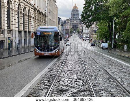 Brussels, Belgium, May 2, 2020 - A bus, public transport, rue de la régence during the confinement period.
