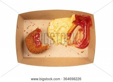 Partly Eaten Brown Crusty Dutch Kroket With Mustard And Ketchup Isolated On A White Background