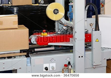 Automated packing and labeling machine for boxes poster