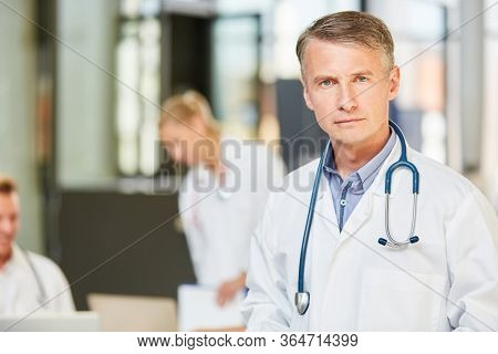 Man as senior physician with competence and responsibility in a hospital or hospital