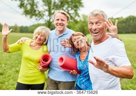Senior group laugh as good friends and have fun in the park in summer